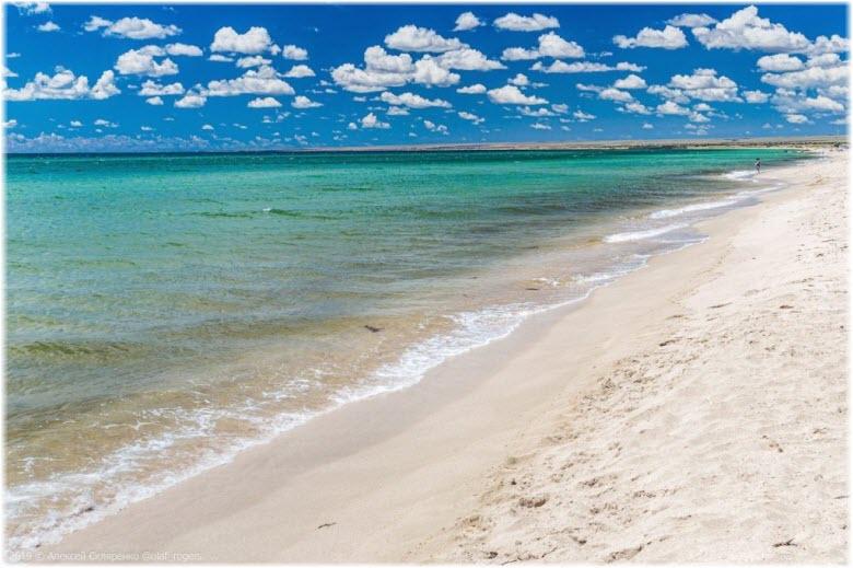 белый песок пляжей косы Беляус
